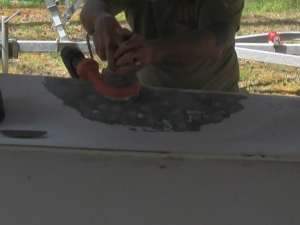 sanding to prepare for fiberglass repair