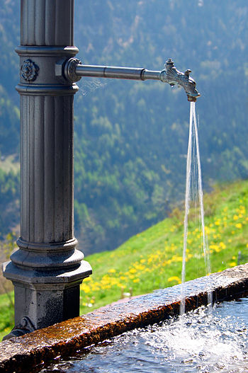 English: Water fountain found in a small Swiss...