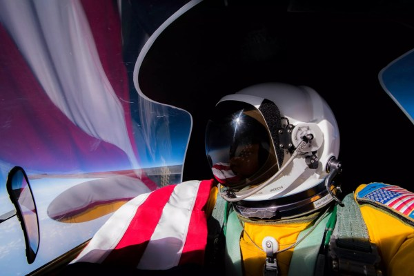 u-2 pilot selfie with flag and reflection on canopy