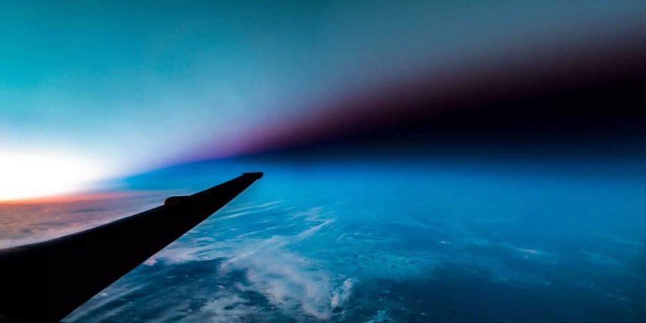 u-2 spyplane flies through the terminator line between light and dark at sunset