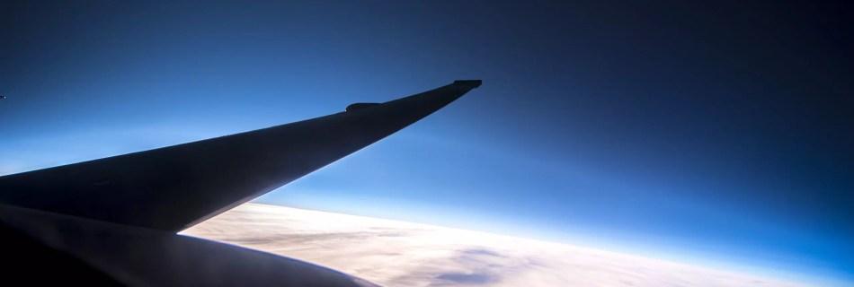 looking down the wing of a U-2 dragonlady spyplane high altitude