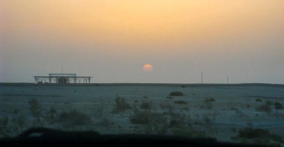 sun setting over the desert landscape