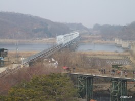 The bridge with people on is The Freedom Bridge. The other is the only train bridge that goes to North Korea.