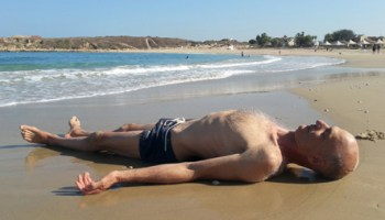 a person lying on a beach