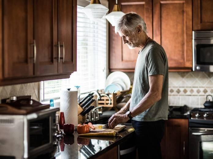 Man cooking in home kitchen