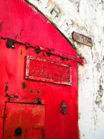 A rustic red door in Road Town, Tortola