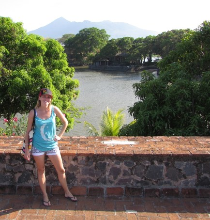 Gringo Katie with the view of islands and a volcano in the background
