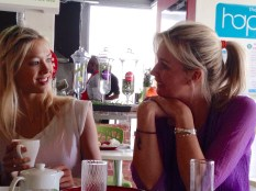 Sharni chatting to one of her sexy yogis over lunch