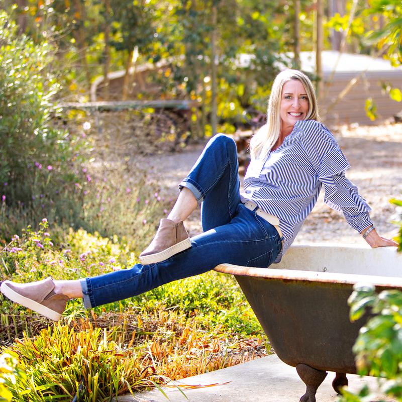 Photo: Sarah sits on the edge of a bathtub