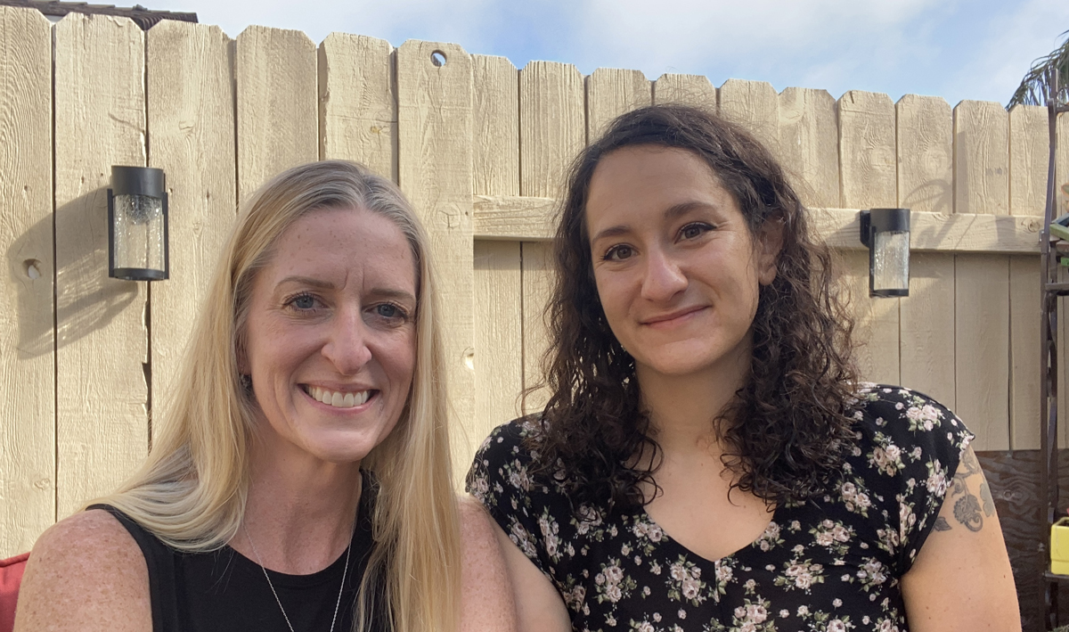 Sarah Kirwan MSPA and Molly Bloom PhD, co-hosts of the Incluse This! Podcast, sit side-by-side outdoors on a patio.