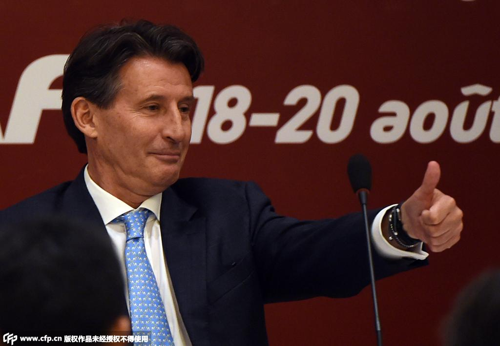 Newly elected International Association of Athletics Federations (IAAF) president Sebastian Coe gives the thumbs-up sign at a press conference after his election at the IAAF Congress in Beijing on August 19, 2015. Britain's Sebastian Coe beat Sergey Bubka in a tight vote to become the new president of world athletics body the IAAF August 19 with a series of doping controversies at the top of his agenda.  AFP PHOTO / GREG BAKER
