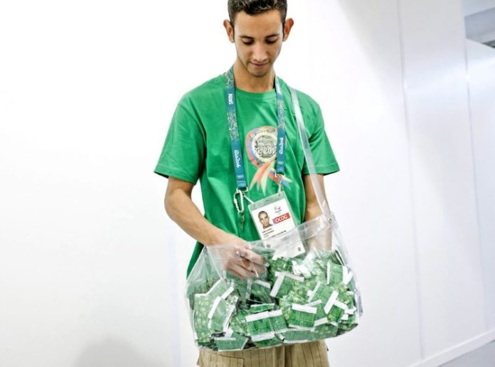 rs_1024x759-160812132903-1024-rio-staff-member-handing-out-condoms-olympic-village-081215