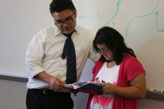 (TARAH JOHNSON/EYE OF THE TIGER) Quiñonez follows along as Cristina Quiñonez reads through an assignment.
