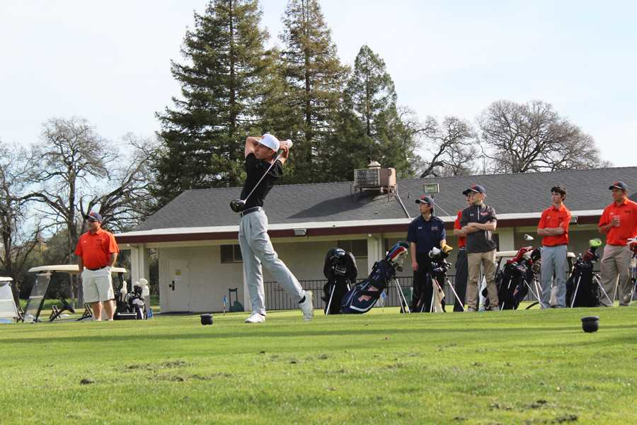 (COURTESY/COREY FUKAMAN) Littlejohn, the number one player on the varsity golf team, hits a drive down the fairway of the first hole at Sierra View Country Club.
