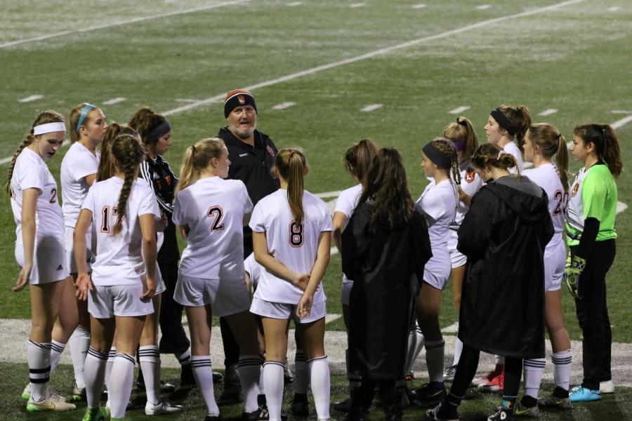 (NICK PROVENCAL EYE OF THE TIGER)  Varsity soccer team coach Paul Stewart addresses his team before their game against Del Campo. The girls team was originally forced to forfeit three games before successfully appealing the ruling.