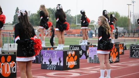 Above, cheerleaders perform at a football game last fall. The team is now working with their third coach this year. In order to increase retention of coaches, RJUHSD formed an Athletics Ad Hoc Committee.