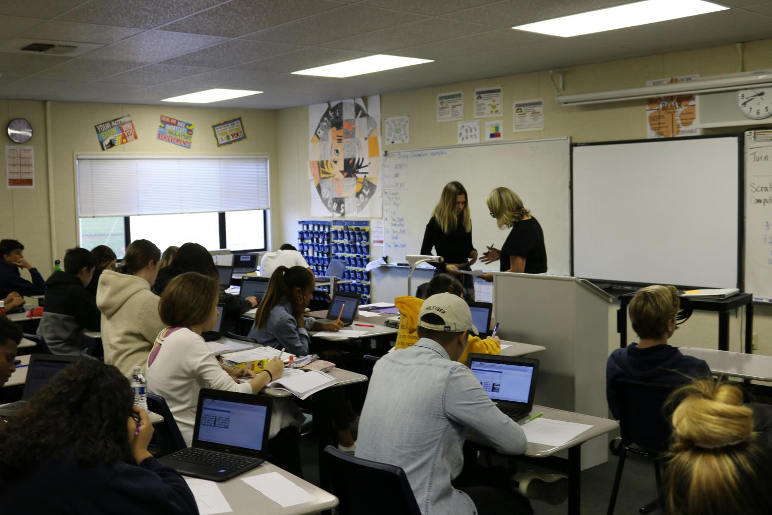 Integrated math teacher Sandra Schmatjen instructs a class of IM2 students. Schmatjen works with her Professional Learning Team to adapt to new course curriculum.