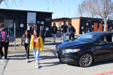 Pictured, students exit the Senior Lot after school last Thursday. Senior Lot is one of two designated parking lots for students and typically fills up 25 minutes before the start of school.