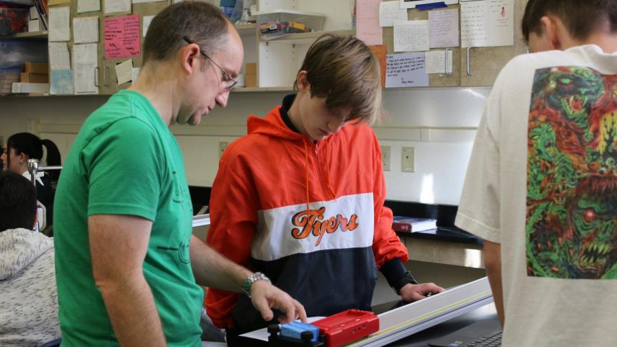 Science teacher Oliver Weiss assists junior Shane Meadows-Yaw in his first period NGSS Physics class.