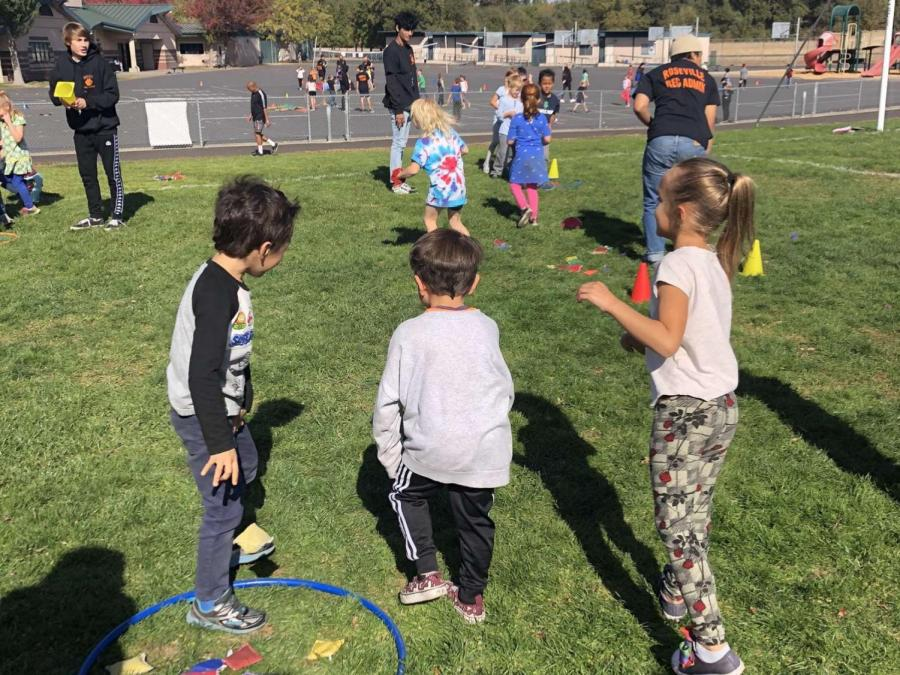 Elementary school students work with Roseville High rec admin students to practice physical education. Now that students cannot visit elementary schools, the class needs new curriculum.