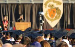 Students and guests attend Roseville High School's 2019 graduation ceremony, held on Hanson field. This year, graduates will walk across a stage in front of the administration building.