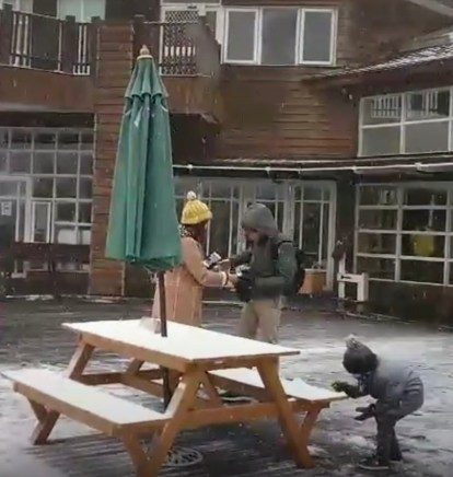 Tourists have fun playing in the snow-covered Taiping