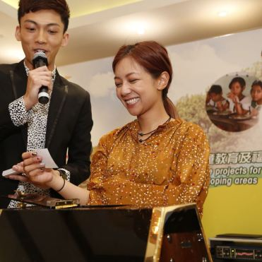 Photo shows Hong Kong TV actress and singer Stephanie Ho, right, and Rio Lee, the event's emcee