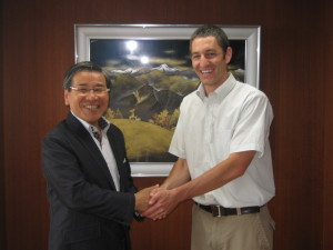 Negotiating eyeglass frame partnership with mayor