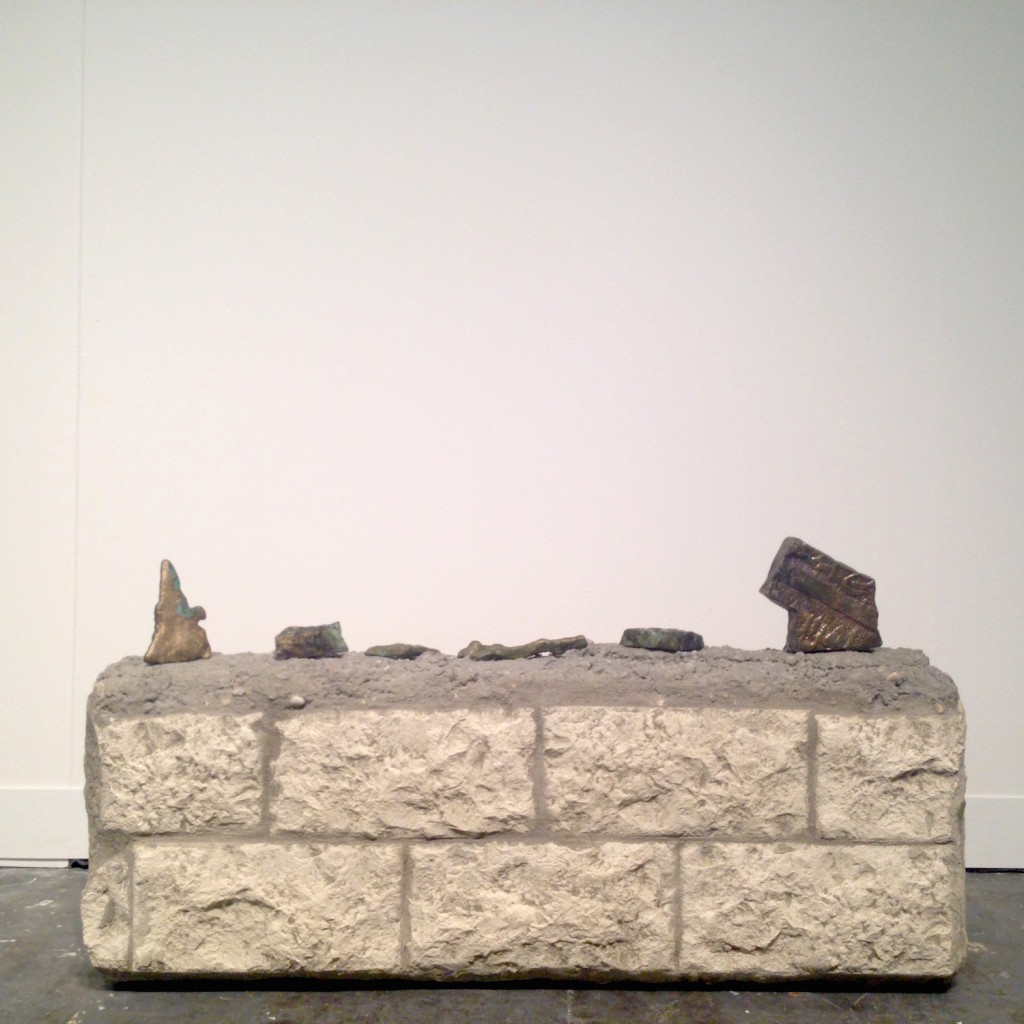 Jumana Manna, Tombstones fragments, from Al-Kazakhani Graveyard series, Unlicensed Porch, 2010/2014, Broze casts of corroded tombstones, CRG Gallery, New York, Photograph by Katy Hamer, The Armory Show, 2015