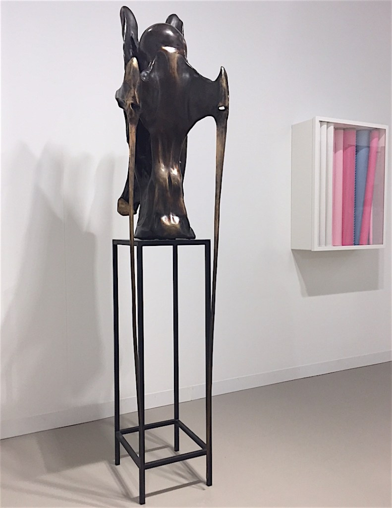 "(Left) Alicja Kwade, ""Urform III"" 2016, Bronze, (Right) Andreas Schmitten, ""Falsche Scham IV"" 2016, Metal, polyurethane, fabric, lacquer, cardboard, König Galerie, Berlin, Art Basel Miami Beach, Photograph by Katy Hamer, 2016"