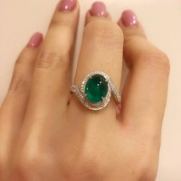 A Wonderful Cabochon Cut Colombian Emerald and Diamond Ring