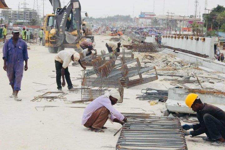 Workers on Ajah Bridge