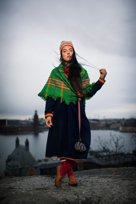 """170318 Maxida MŠrak, artist, poses for a portrait on March 18, 2017 in Stockholm, Sweden. """"When I grew up I didnÕt think there was anyone in S‡pmi who could fully represent us. There were no people who wasnÕt turncoats, so I really lacked role models in terms of the Sami struggle and indigenous rights, the political indigenous issues. So then I simply decided to become that person myself, who will never turn her coat after the wind. And who may react more actively than simply in theory."""" """"In 2014 I was taking part in a demonstration against the mine in Jokkmokk, with my child in a stroller. There came a man leaping against me on the street. He took my stroller with my daughter in it, threw it around, swore and ran away from there. Because it was me who was there. Then I felt how damn important it is to resist when it even becomes physical and literally affects your children."""" Photo: Joel Marklund / BILDBYRN"""