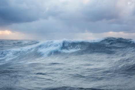 A wave is photographed during a crossing of the Atlantic Ocean on board of the Avontuur, a German-flagged commercial sailing cargo vessel which transports goods from Montreal, Canada to La Rochelle, France. During the crossing, undertaken in the winter, the ship has encountered heavy winds and storms up to force 10. The traditionally-rigged two-masted schooner's mission is to inspire more companies to undertake cargo sailing, using renewable energy as an alternative to the high pollution rates of the modern cargo shipping industry. Atlantic Ocean.