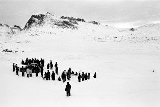 GREENLAND. Tiniteqilaaq. 2000. An old hunter is dead and most of the settlement is attending the funeral. The body is kept in the coffin until summer, when the ground gets soft and it is possible to bury the corpse.