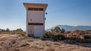 Electrical sub-station on hill with mountains in background. Patara Turkey. Landscape Colour. P.Maton 2014 eyeteeth.net