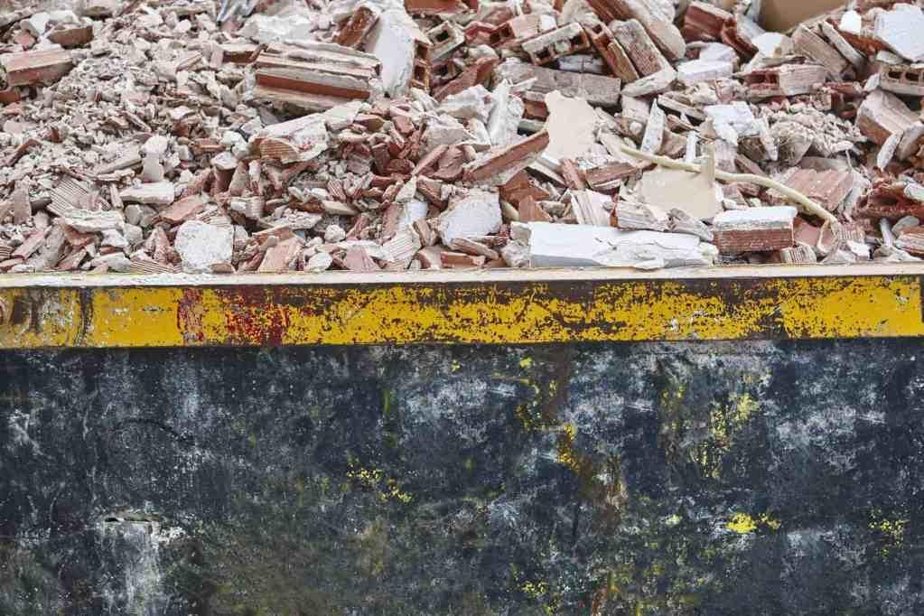 Removal of debris. Construction waste. Building demolition. Devastation background