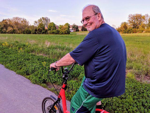 EZ E-Bike Rentals Owner, Jim Yanan, riding on a Juiced E-Bike