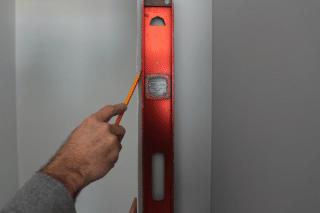 install a pre-hung door, mark it, step 1