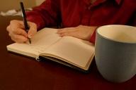 man-journaling