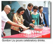 Gordon Liu pours celebratory drinks
