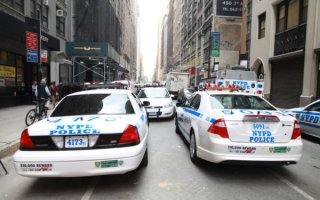 September 30, 2014 - New York, NY: NYPD ESU units leave 225 West 35th street packing up, having not found the hotel robber. The robber would be found later by regular uniformed police. Two Swedish tourists, Andreas Mansson and Viktor Lofgren were the victims of a robbery at the Wingate by Wyndham on 35th street and 8th avenue in Manhattan. NYPD later caught the man in the building next door, 225 west 35th street. The robber then passed out after being caught and was taken away in an ambulance.