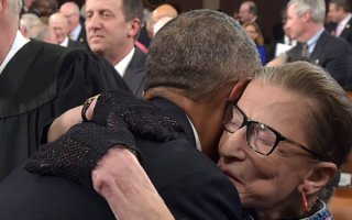 WASHINGTON, DC - JANUARY 20:  U.S. President Barack Obama hugs Supreme Court Justice Ruth Bader Ginsburg as arrives to deliver the State of the Union address on January 20, 2015 in the House Chamber of the U.S. Capitol in Washington, DC. Obama was expected to lay out a broad agenda to address income inequality, making it easier for Americans to afford college education, and child care.  (Photo by Mandel Ngan-Pool/Getty Images)