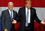 Republican U.S. presidential candidate Donald Trump (R) and Indiana Governor Mike Pence (L) wave to the crowd before addressing the crowd during a campaign stop at the Grand Park Events Center in Westfield, Indiana, July 12, 2016. REUTERS/John Sommers II