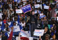 A Donald Trump supporter disrupts remarks by U.S. President Barack Obama at a Hillary for America campaign event at the Fayetteville State University in Fayetteville, North Carolina, U.S., November 4, 2016. REUTERS/Jonathan Ernst