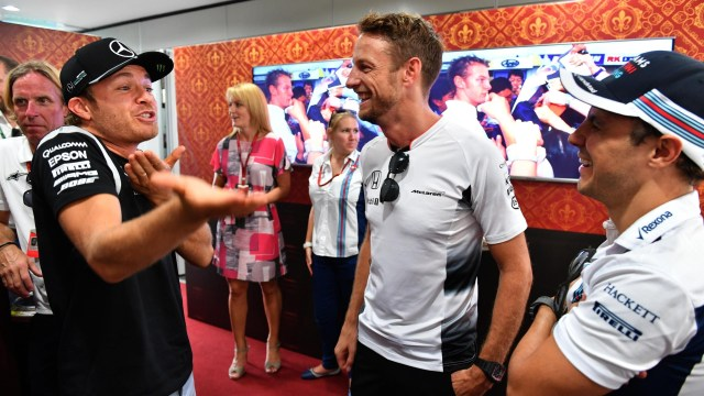 Jenson Button (GBR) McLaren celebrates his 300th Grand Prix with Nico Rosberg (GER) Mercedes AMG F1 and Felipe Massa (BRA) Williams at Formula One World Championship, Rd16, Malaysian Grand Prix, Practice, Sepang, Malaysia, Friday 30 September 2016. © Sutton Images