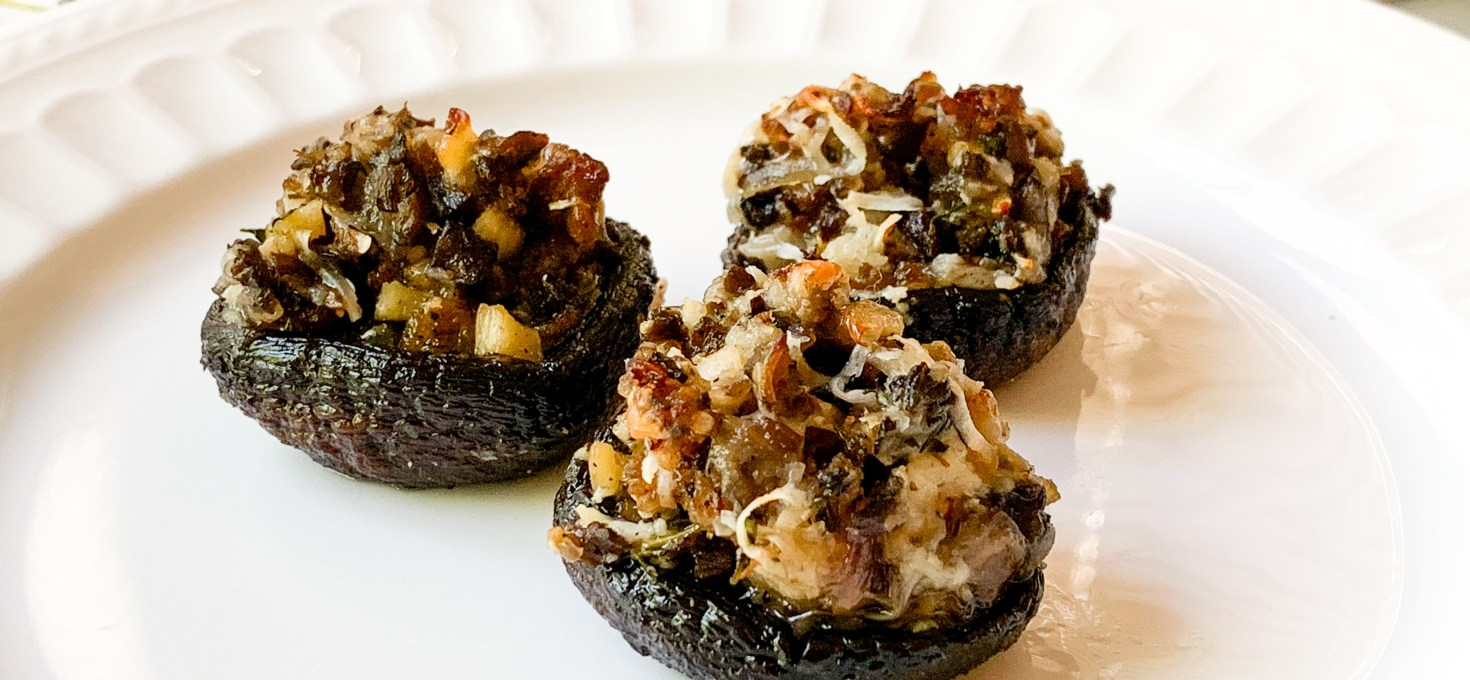 Spicy Sausage, Truffle Goat Cheese, and Thyme Stuffed Mushrooms