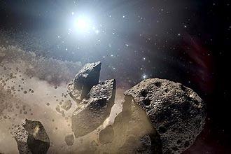 Concepção artistica mostra estrela morta cercada por pedaços de um asteroide que se desintegra
