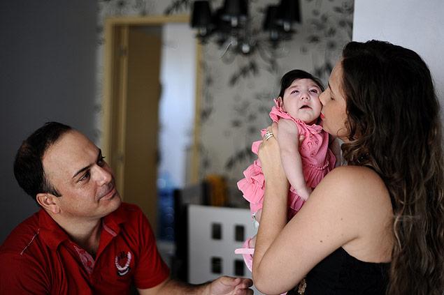 O casal Luciano e Suzana com a filha Ana Laura