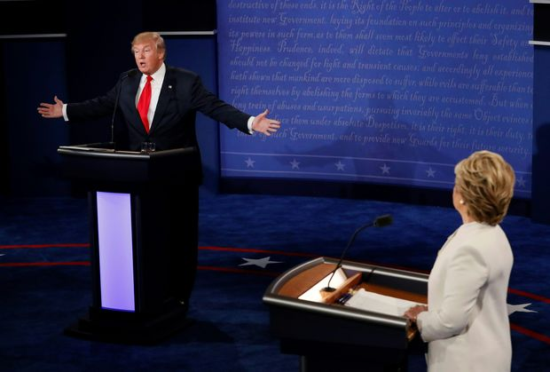 Republican presidential nominee Donald Trump speaks as Democratic presidential nominee Hillary Clinton (R) looks on during the final presidential debate at the Thomas & Mack Center on the campus of the University of Las Vegas in Las Vegas, Nevada on October 19, 2016.